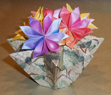 Origami videos 8 cornered basket 8 cornered vase filled with 8 petal flowers mightylinksfo